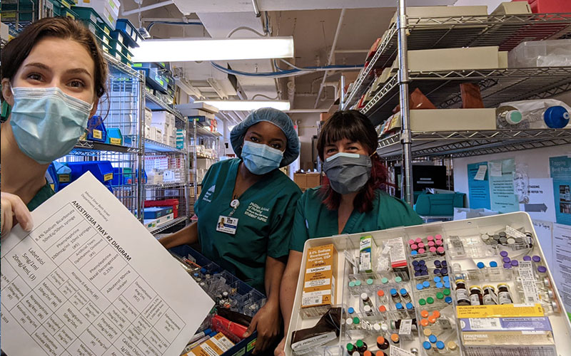 Nursing student volunteers, from left, Pearl Scalzo, Sylvie Jean Baptiste, and Jacky Lee stocked emergency trays for the Mount Sinai Beth Israel Pharmacy.
